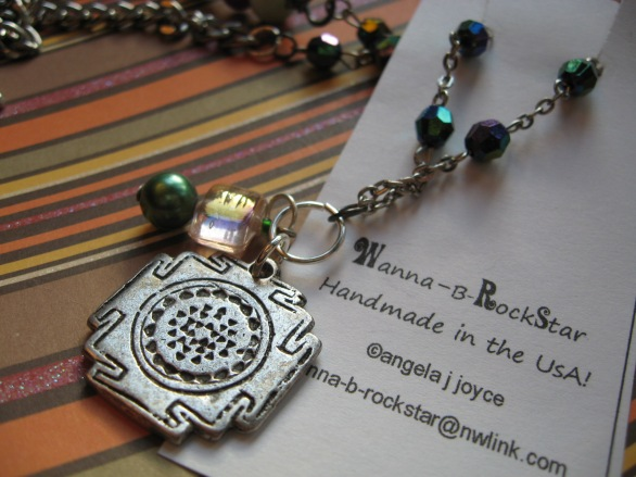 Fun up-cycled elements make this wearable necklace